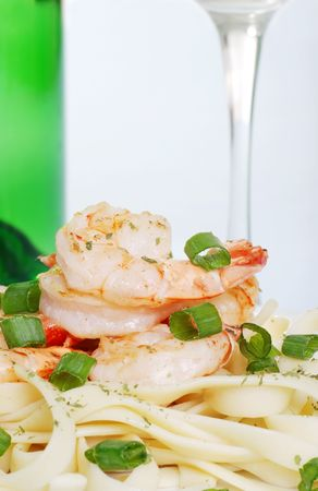 macro shrimp with noodles and white wine photo