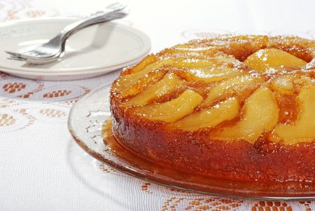 upside: Upside Down Pear Cake With Plates And Forks Stock Photo