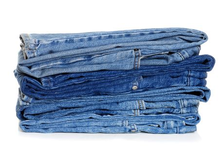 heap: Pile Of Folded Blue Jeans Stock Photo