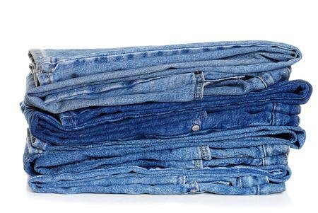 legs folded: Pile Of Folded Blue Jeans Stock Photo