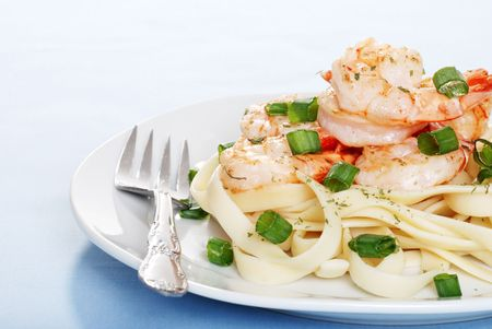 shrimp with noodles and fork photo