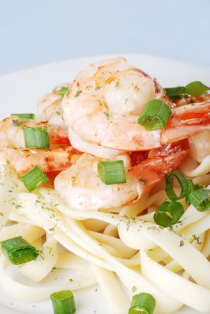 top view shrimp with spring onions and noodles shallow dof photo