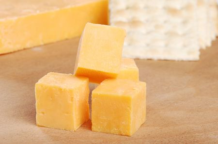 crackers: cheddar cheese and crackers focus on top cube