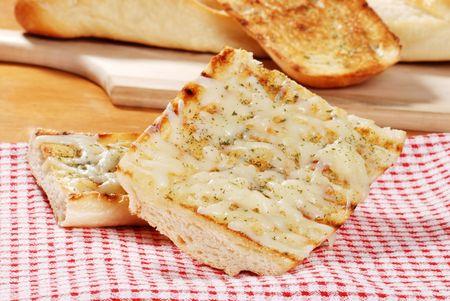 mozzarella cheese garlic bread on napkin photo