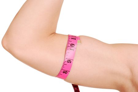 female arm with tape measure around bicep photo