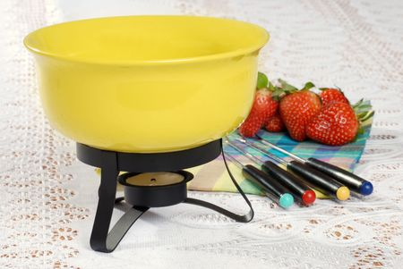 fondue set focus on bowl rim photo