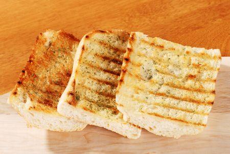 garlic bread with cutting board photo