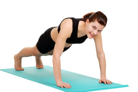 young brunette woman doing push ups Imagens