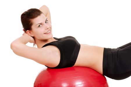 body toning: young woman using exercise ball