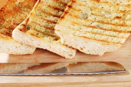 closeup garlic bread with knife photo