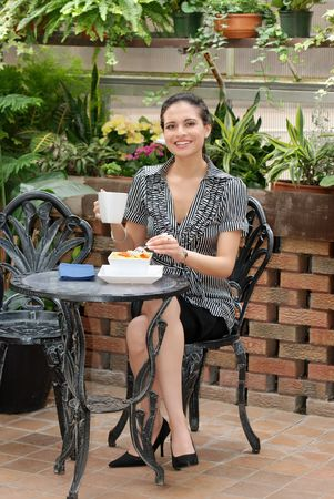 woman eating in a patio photo