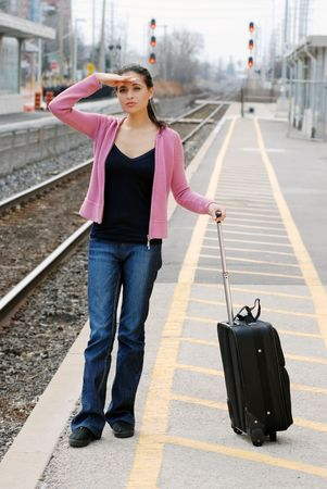 woman looking for the train photo