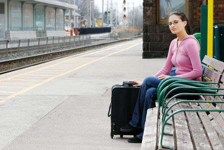 woman waiting at the train station photo