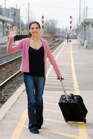 woman waving at train station Banque d'images