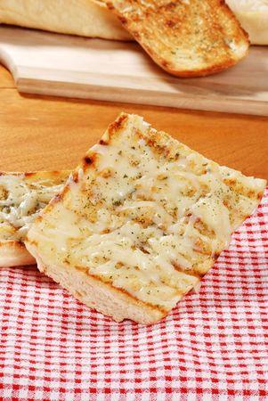 garlic bread on red white checkered napkin photo