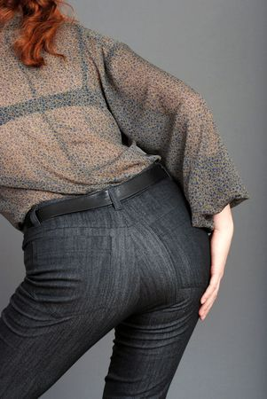 ass standing: woman behind wearing jeans Stock Photo