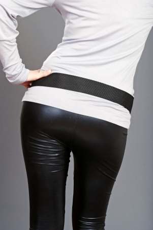 woman bottom wearing black leather pants
