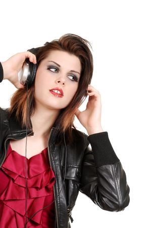 brunette woman listening to music with headphones photo