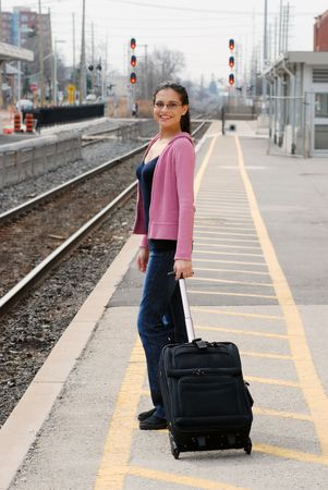 Happy woman waiting for a train photo