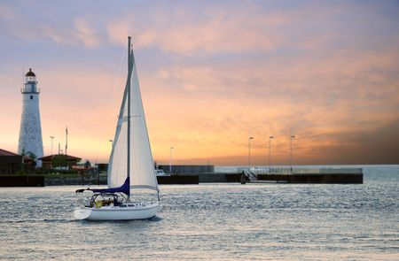 lighthouses: sailboat leaving marina