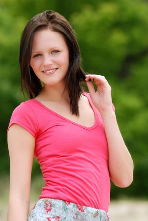 young woman wearing a pink t shirt photo