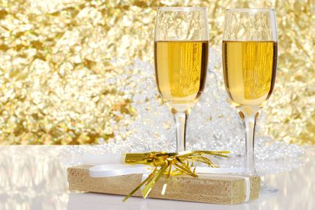noise maker: fluted champagne and a present