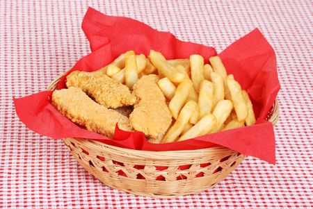 baked chicken: chicken fingers and french fries Stock Photo