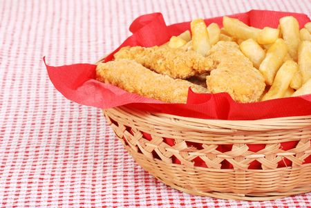 dinnertime: chicken fingers and french fries in a basket
