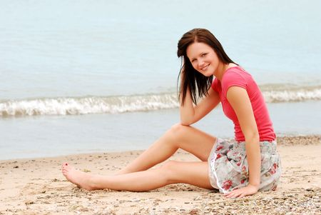 Happy woman relaxing on beach photo