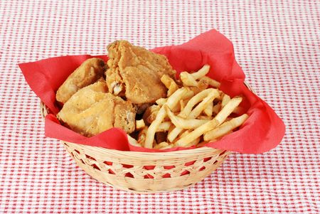 suppertime: fried chicken and french fries in basket
