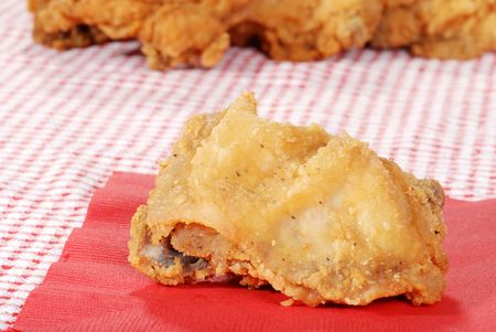 suppertime: fried chicken on red napkin Stock Photo