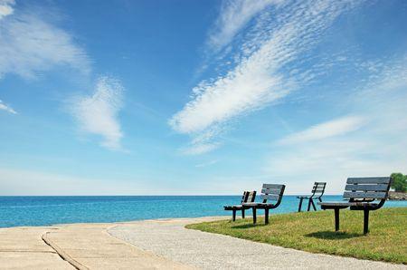 row of park benchs photo