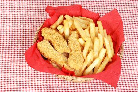 top view chicken fingers and french fries photo