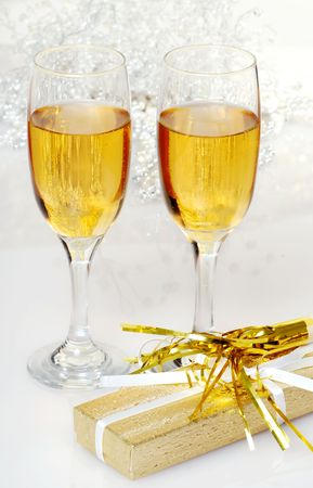 two glasses of champagne with present and horn photo