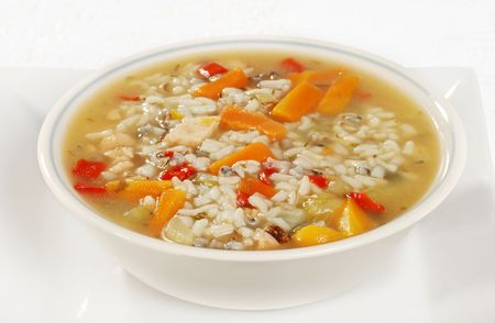 broth: bowl of chicken and wild rice soup with vegetables