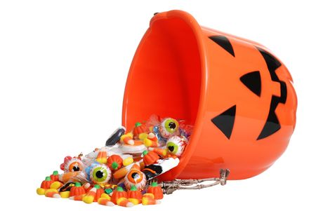 halloween skeleton: child halloween pumpkin bucket spilling candy