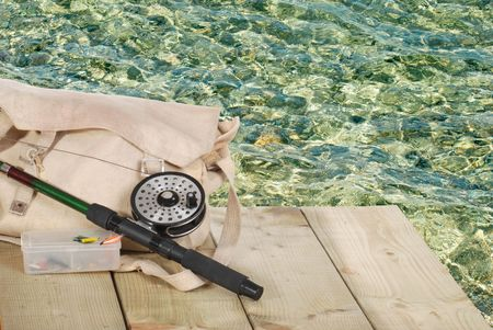 fly fishing equipment on a dock photo