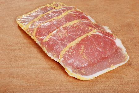 uncooked bacon: peameal bacon on wood cutting board Stock Photo