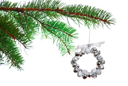 silver Christmas bell wreath on a branch Stock Photo - 8337707