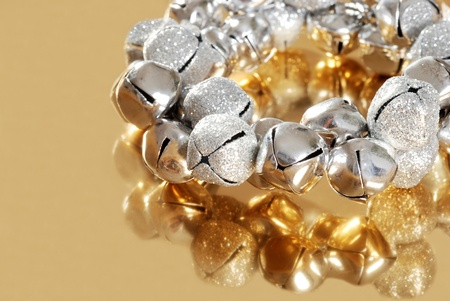 silver jingle bells with gold reflection photo