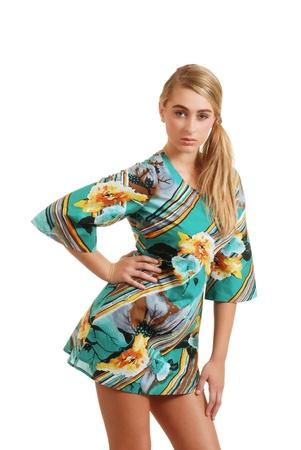 若い 10 代の夏の花のドレスを着ています。 写真素材