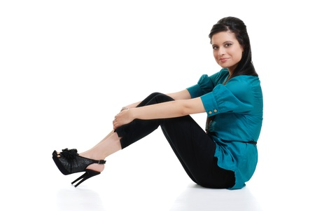 hispanic woman sitting wearing blue top photo