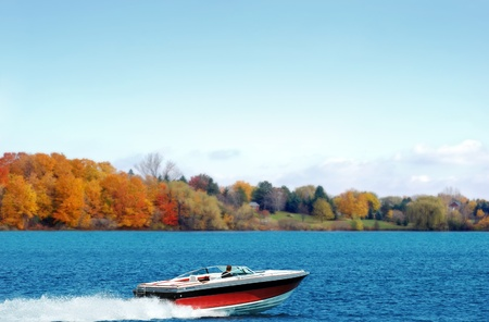 motor boat: power boating on an autumn lake Stock Photo