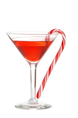 copa martini: martini rojo con un bast�n de caramelo Foto de archivo