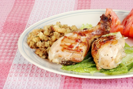 stuffing: barbecue chicken drumsticks with stuffing and vegetables