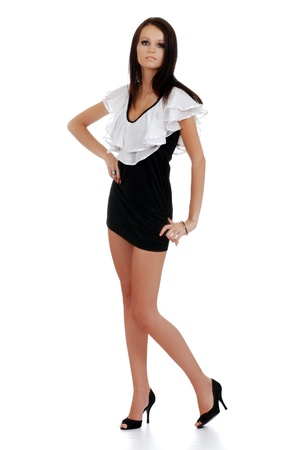 young woman wearing white and black dress