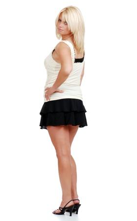 mini falda: madura mujer rubia en mini falda Foto de archivo