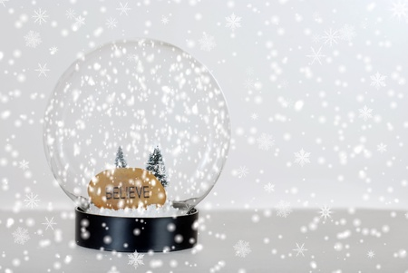 Christmas believe snow globe Stock Photo - 10668961