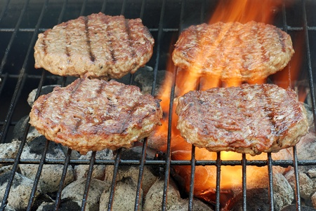 barbecuing: four barbecue hamburgers
