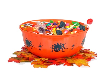 halloween candy in a bowl with fall leaves photo